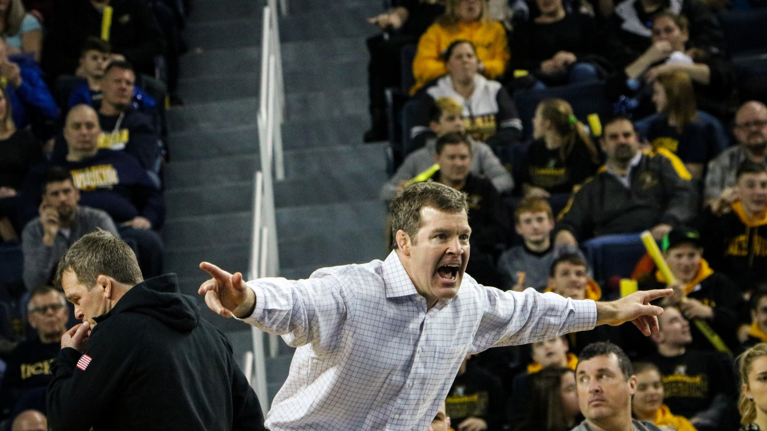 Iowa head coach Tom Brands voices his displeasure on the edge of the mat.