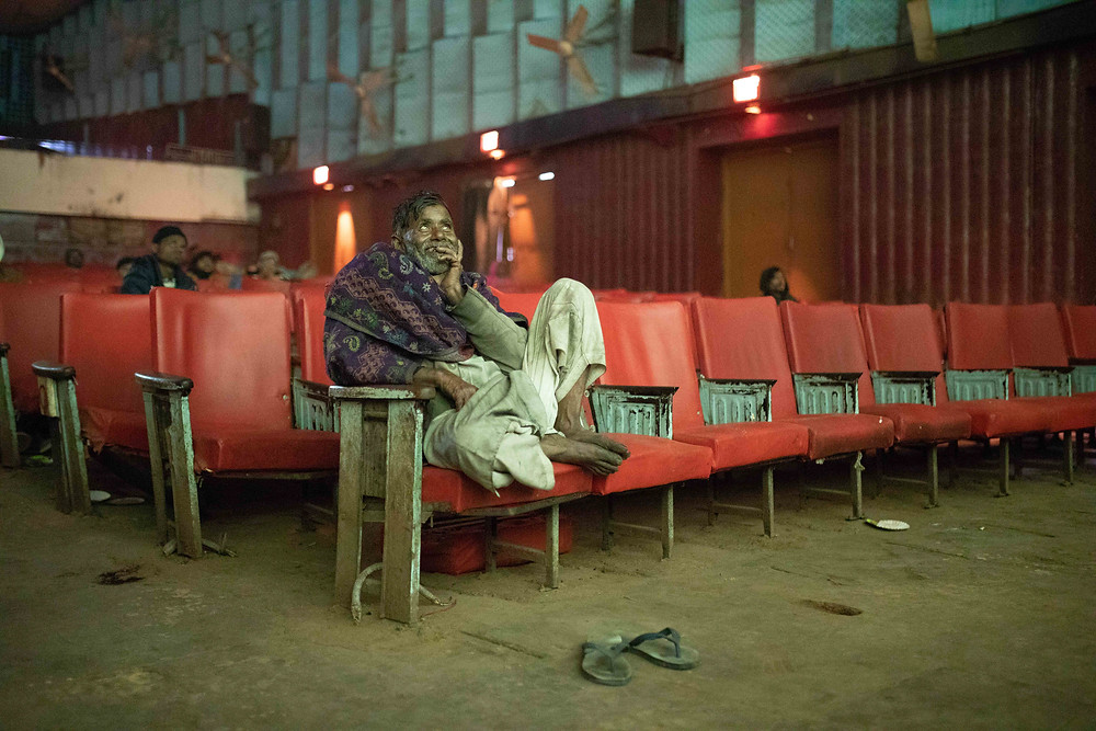 Ram Kumar, a daily wage labourer enjoying a movie. Moti Talkies is often a refuge for refuge socio-economically weak section of migrant labourers and is the only theatre in Old Delhi to which shows regional Bhojpuri movies that this working class diaspora speaks.