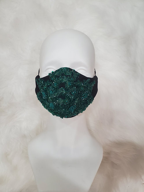 Black mask with emerald green applique