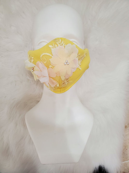 Yellow mask with 3D flowers