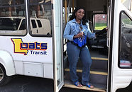 This is a picture of a young lady boarding the bus.