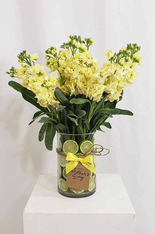 Fresh Limes and Fresh Yellow Snapdragon Flowers