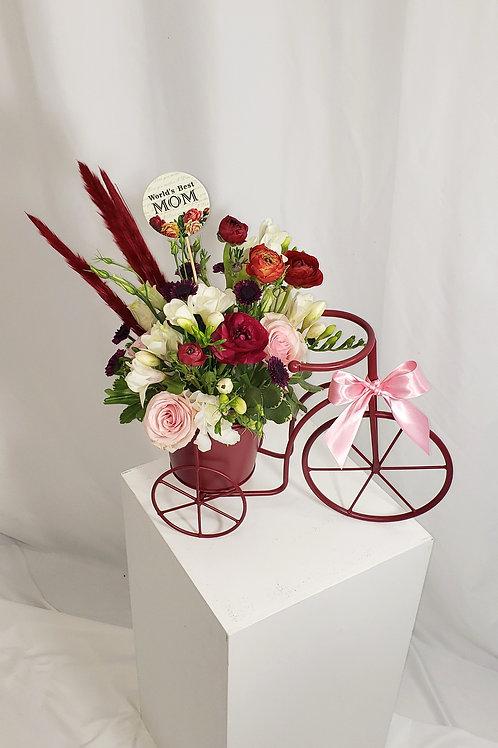Ranunculus Flowers on Red Wheels