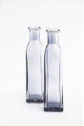 Small black glass bottle