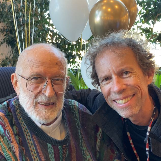 Father James Plough with Larry Cappetto