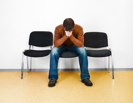 stressed man in a waiting room