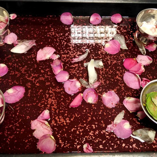 Rice, petals and coloured water