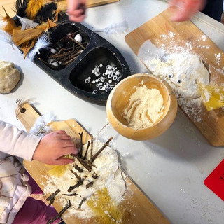 Children making their own chicks with dough, feathers, sticks and googley eyes!