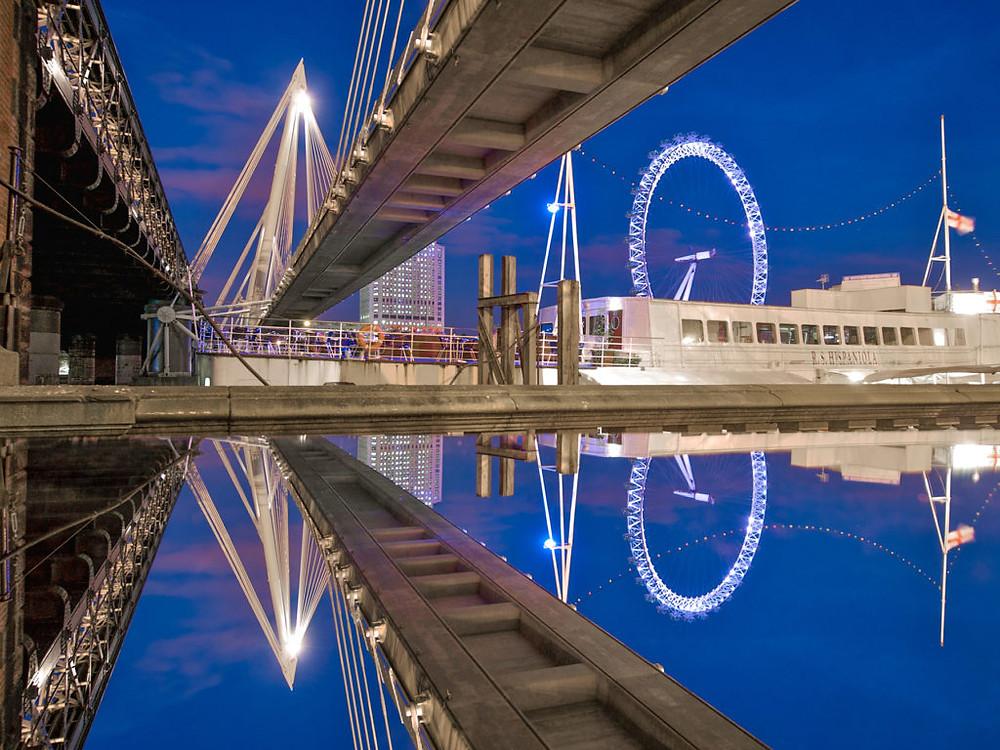 reflection photo of jubilee bridge and london eye during twilight