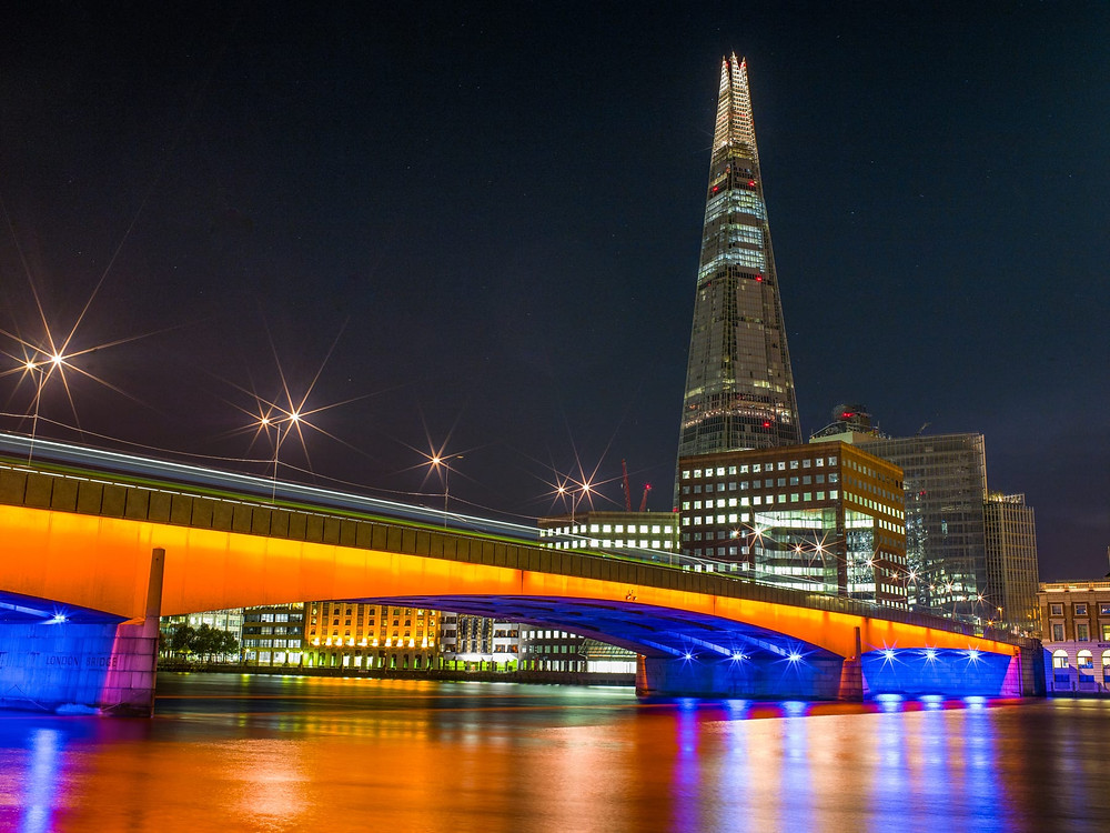 london bridge and the shard illuminated at night