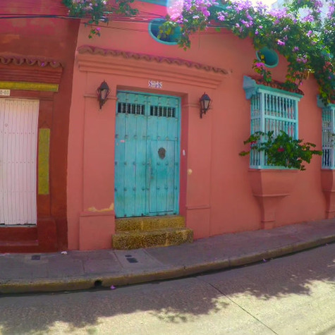 Mark Paulda photographing an ornate door in the old historic city of Cartagena Colombia.