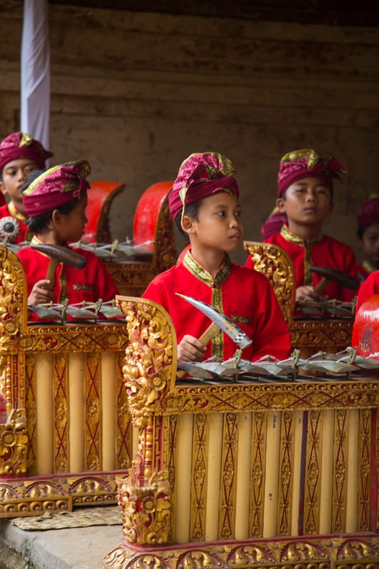 Balinese children playing music at a temple in Bali.