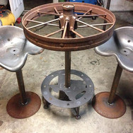 Metal bar table with stools
