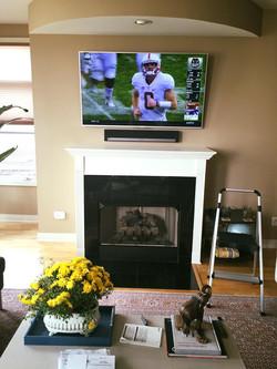 TV + Sound bar over fireplace