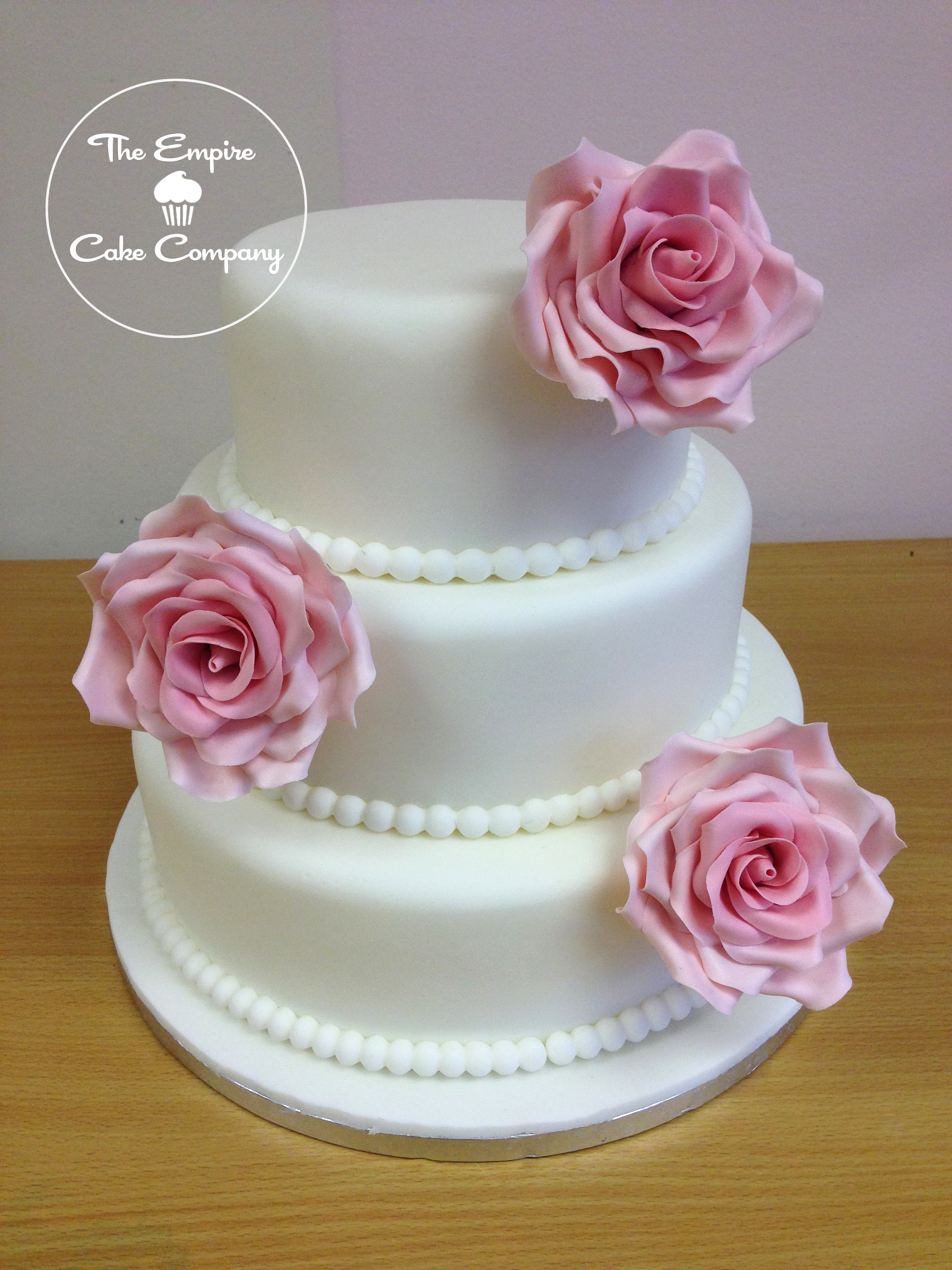 wedding cakes with roses and pearls empirecakecompany roses and pearls wedding cake 26108