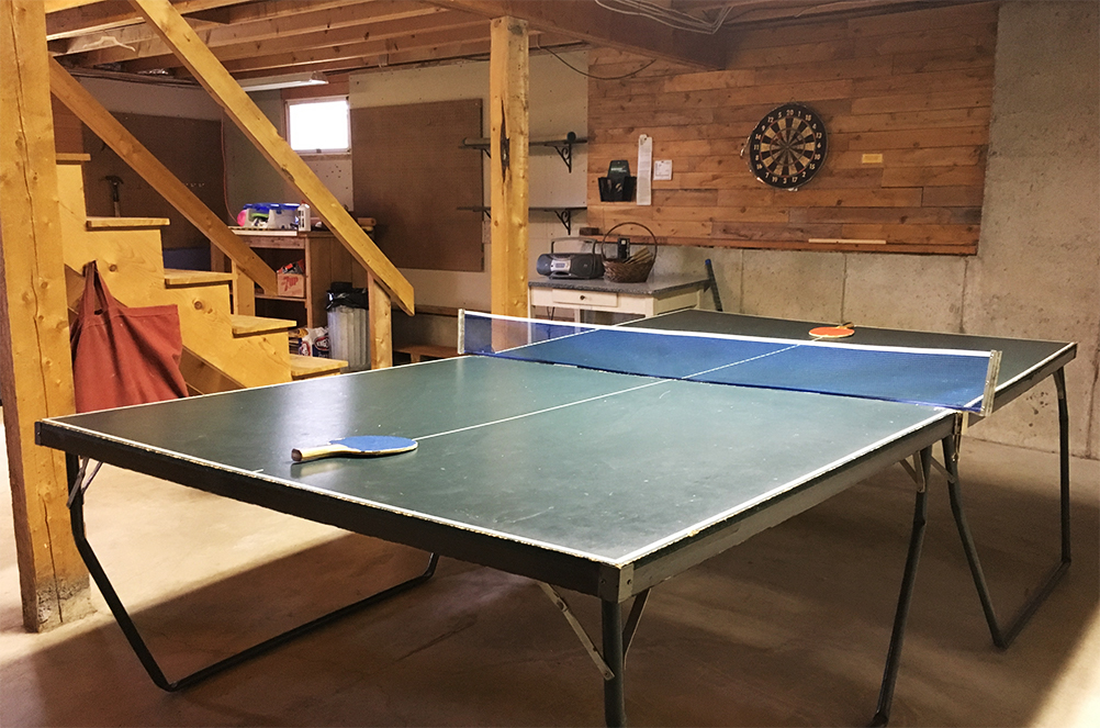 Ping-pong table and dart board