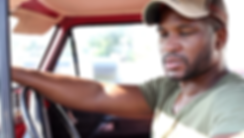 african-american-male-sitting-in-pickup-