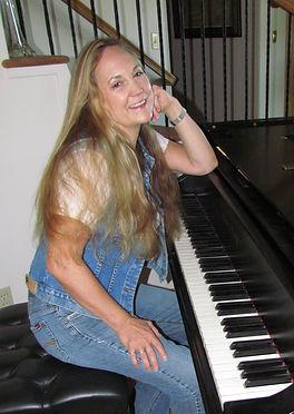 Brenda-at-Piano-less-cropped.jpg