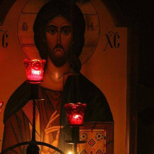 Christ icon with red candles