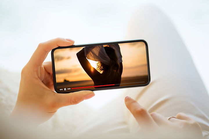 Canva - Woman watching video on mobile p