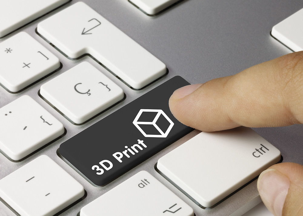 A finger moving towards a keyboard button labelled '3D Print'