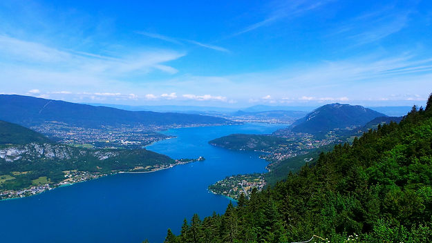 Experience this magical view on our bike tours France, from the top of Col de la Forclaz of Lake Annecy.