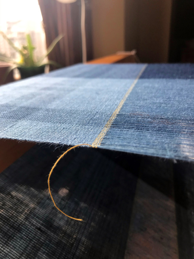 Gossamer linen, dyed in indigo, twill weave, ending in cotton dyed with osage and marigold