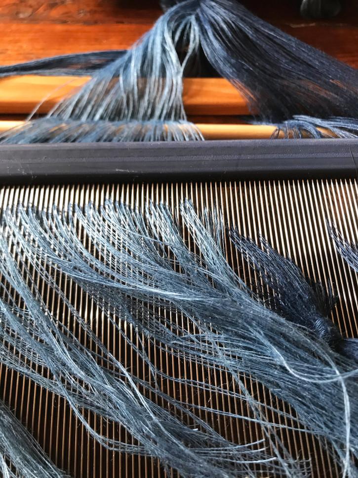 Gossamer linen dyed with indigo, threaded through reed