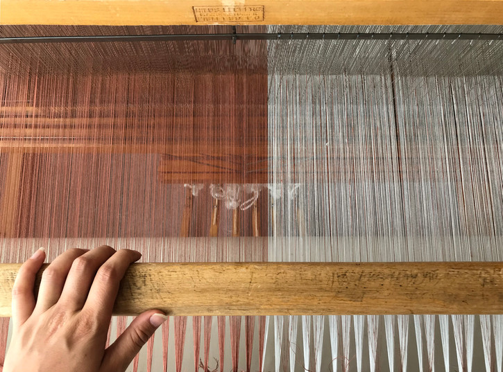 Organic cotton warp threads, undyed and dyed with madder and cutch, loom dressed, ready to weave