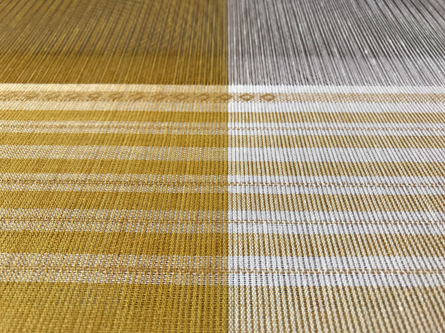 Organic cotton dyed with marigold and osage as warp and weft, supplemental paper thread weft