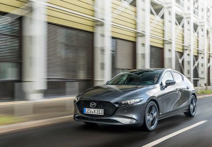 2021 Mazda3 Machine Grey, Action 12.jpg