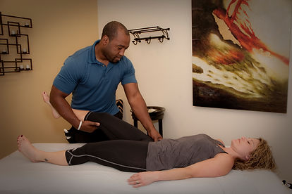 Orthopedic Manipulation Therapist giving woman sports massage.
