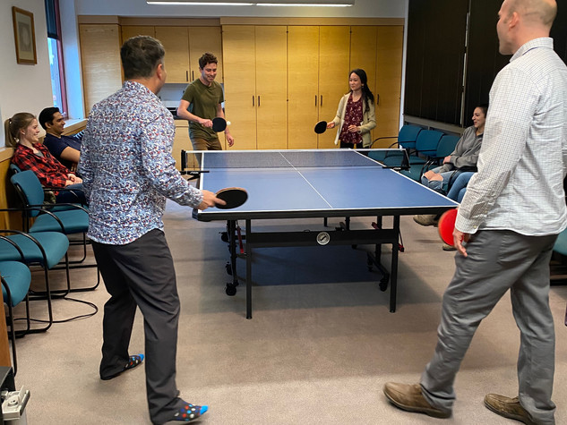Brian and Cybelle square off in the department's March Madness doubles ping pong tournament