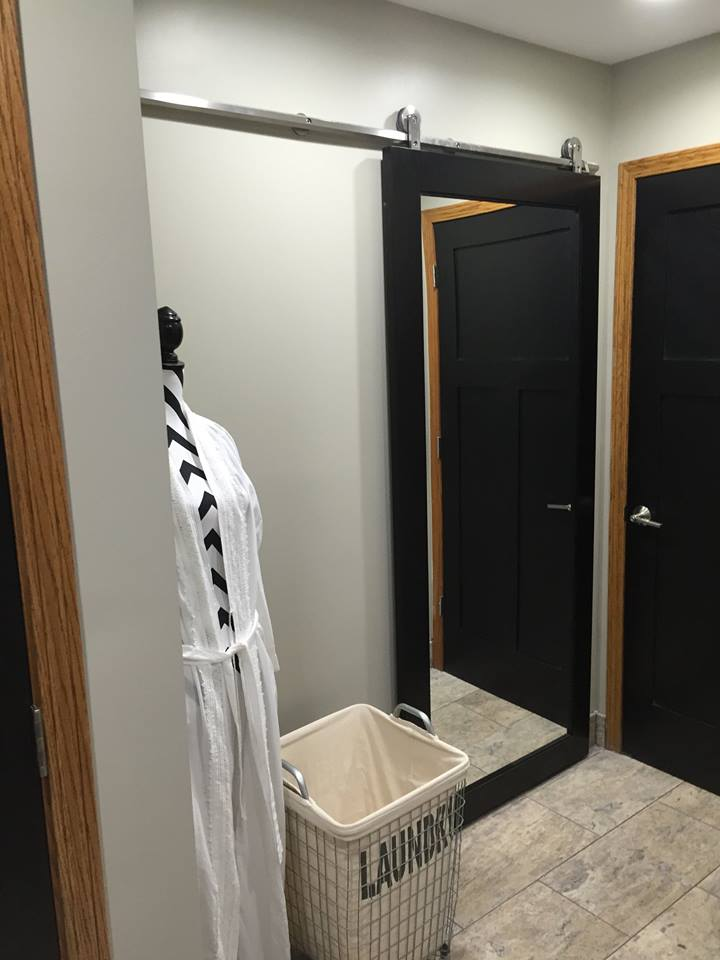 Laundry room with barn doors