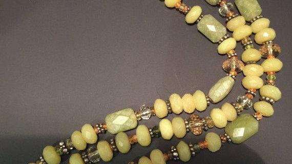 Three strand bracelet ,green garnets,citrine, serpentine  ,,8 inches