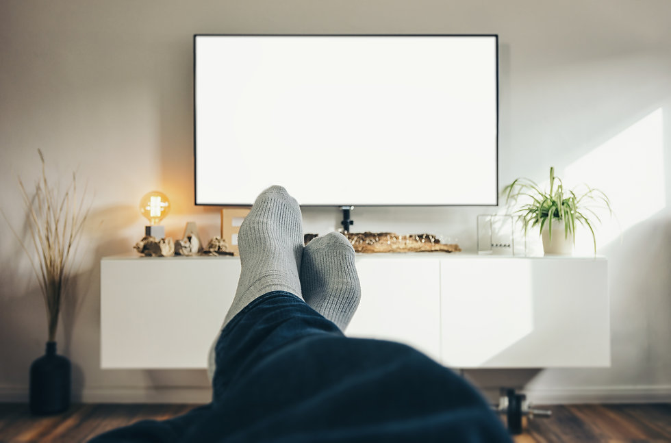 Man Watching TV in his living room, point of view perspective..jpg