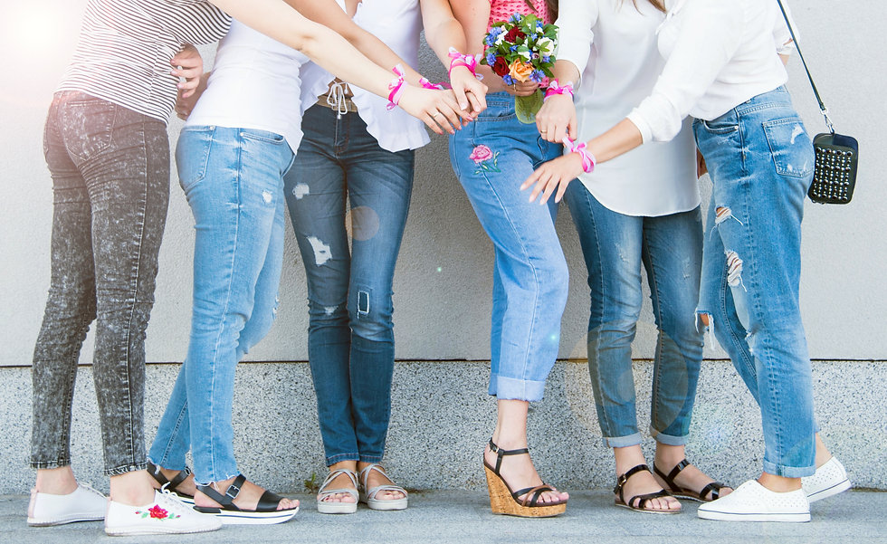 Women near the wall in jeans and t-shirt