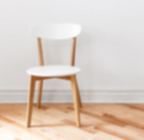 White%20chair%20in%20an%20empty%20room_edited.jpg