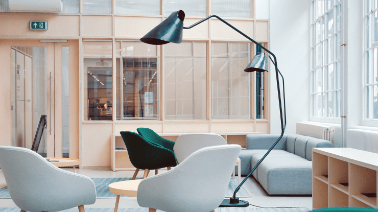 modern office space soft grey chairs sofa and large lamp
