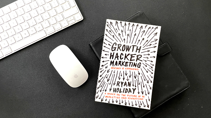 growth hacker marketing book with mac mouse