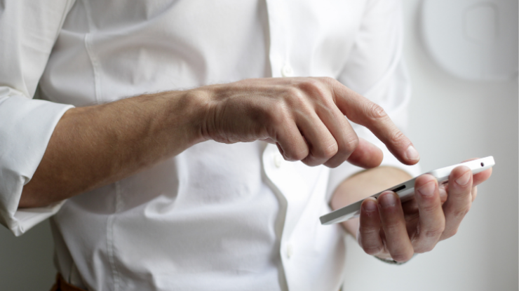man calculating on phone