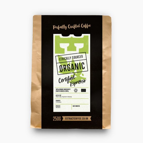 bag of organic coffee with a black white and green label
