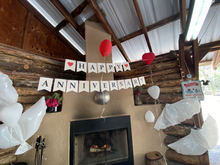 Decorations set the mood of the wood burning fireplace.