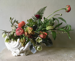Spring flowers in a shell vase