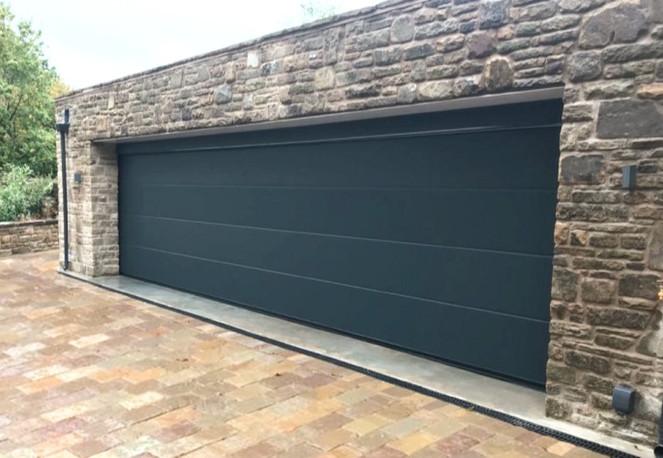 Sectional garage door in Anthracite Grey.