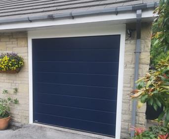 Blue sectional garage door.
