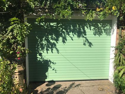 Domestic insulated roller shutter in mint green.