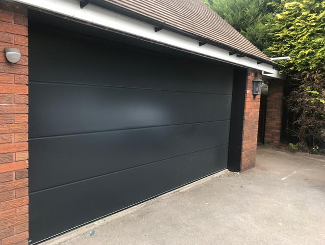 Sectional garage doors Black.