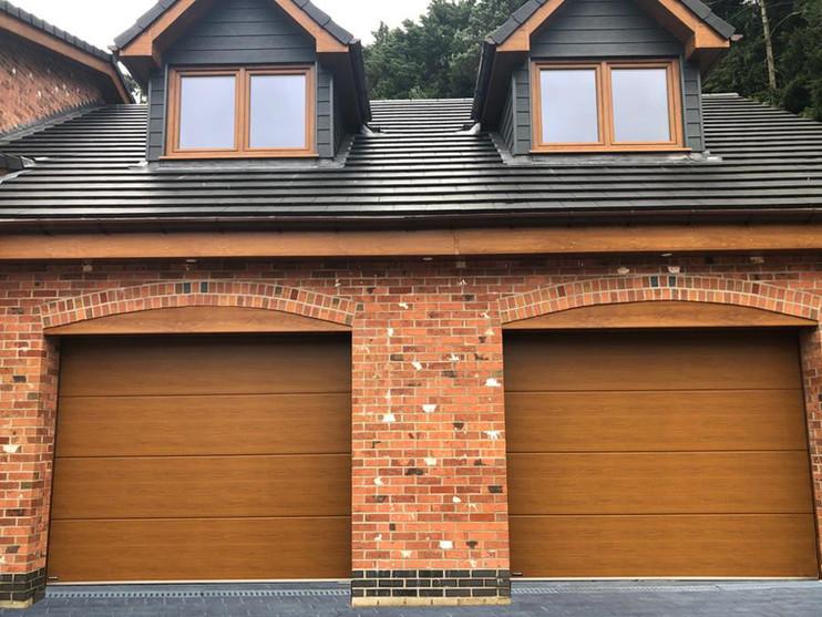 Sectional garage doors in Golden Oak.