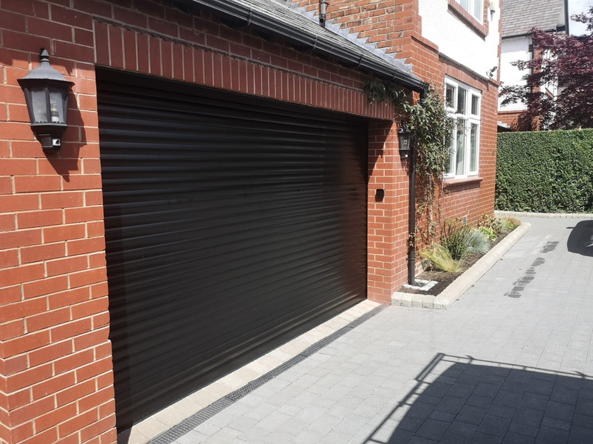 Domestic insulated roller shutter in black.